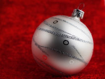 Christmas ball. The Christmas ball on red background Royalty Free Stock Photo