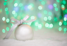 Christmas ball on abstract light background, place for text Stock Photo