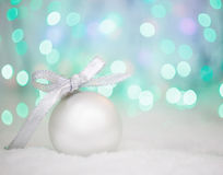 Christmas ball on abstract light background, place for text Royalty Free Stock Photography