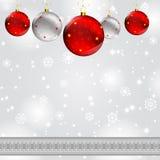 Christmas ball on abstract winter gray Stock Photos