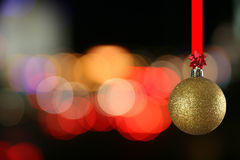 Christmas ball against bluring light. The christmas ball against bluring light stock photo