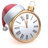 Christmas ball alarm clock New Year`s Eve time midnight hour. Countdown Santa hat decoration bauble ornament golden. Traditional wintertime happy holidays Royalty Free Stock Photography