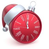Christmas ball alarm clock New Year`s Eve time Santa hat red Royalty Free Stock Photography