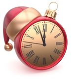 Christmas ball alarm clock New Year`s Eve time Santa hat red Royalty Free Stock Images