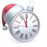 Christmas ball alarm clock New Year`s Eve time Santa hat white Royalty Free Stock Photo