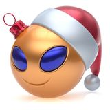 Christmas ball alien face New Year`s Eve bauble smiley cartoon. Cute emoticon decoration gold. Happy Merry Xmas cheerful funny smile Santa hat person character Stock Images