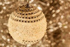 Christmas ball on the background bokeh, sepia Stock Image