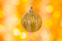 Christmas ball on a background of yellow and orange holiday boke Stock Photography