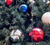 Christmas ball balls and lights. Hanging on a christmas tree Stock Images