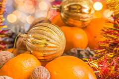Christmas ball in the basket with fruit Royalty Free Stock Image
