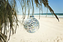 Christmas ball at beach Stock Photos