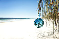 Christmas ball at beach Royalty Free Stock Image