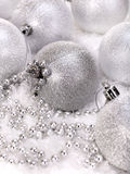Christmas ball and beads in snow. Stock Images