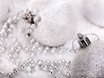 Christmas ball and beads in snow. Royalty Free Stock Images