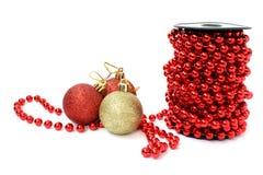 Christmas ball and beads Stock Photos