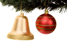 Christmas ball and bell on a xmas tree Stock Photo