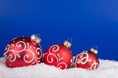 Christmas ball on a blue. Background stock photos