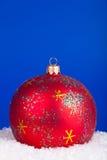 Christmas ball on a blue Stock Image