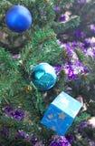 Christmas ball and blue gift Stock Photography