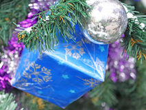 Christmas ball and blue gift Royalty Free Stock Photography