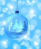 Christmas ball on blue winter background. Royalty Free Stock Photos