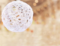Christmas ball on the blurred beige background Stock Images