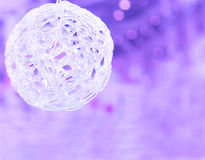 Christmas ball on the blurred purple background Royalty Free Stock Image