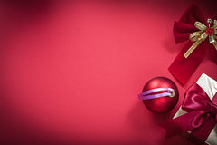 Christmas ball bow giftbox on red background Royalty Free Stock Photography