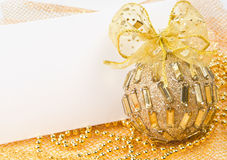 Christmas ball with bow and postcard Royalty Free Stock Photos
