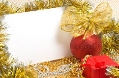 Christmas ball with box and postcard Royalty Free Stock Images