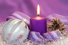 Christmas ball with burning candle Stock Photography