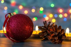 Christmas ball and burning candles. stock photography