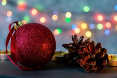 Christmas ball and burning candles. royalty free stock photos