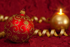 Christmas ball and candle Stock Photos