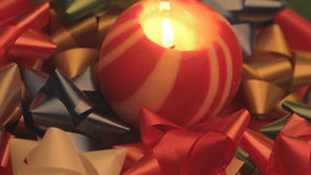 Christmas ball candle and bows 3 stock video