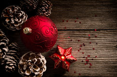 Christmas ball and candle on a wooden top Royalty Free Stock Images