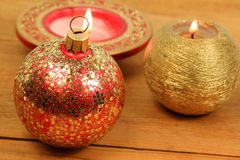 Christmas ball and candles Royalty Free Stock Photos