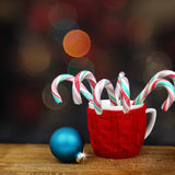 Christmas ball and candy canes Stock Photos