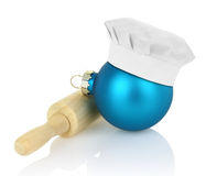Christmas ball with chef hat and rolling pin Royalty Free Stock Image