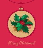 Christmas ball with  Christmas holly Stock Photo