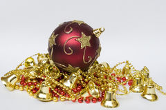 Christmas ball on colored pearls and bell Royalty Free Stock Photography