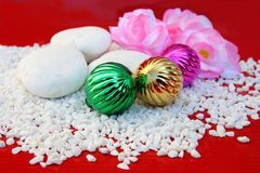 Christmas ball on crushed stone Royalty Free Stock Photo