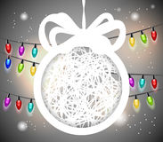 Christmas ball cut from paper on gray background. Royalty Free Stock Photos