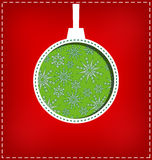 Christmas ball cutout on red Royalty Free Stock Photo