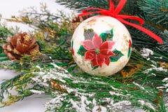 Christmas ball. Christmas decoration with colorful ball and fir-tree branch Royalty Free Stock Image