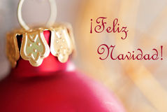 Christmas Ball Decoration with Feliz Navidad. Red Christmas Ball Decoration with the Spanish Words Feliz Navidad which means Merry Christmas Stock Image