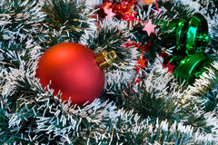 Christmas ball and decorations. Christmas red ball and decoration ornaments on the background Royalty Free Stock Images