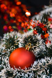 Christmas ball and decorations. Christmas red ball and decoration ornaments on the background Royalty Free Stock Photography