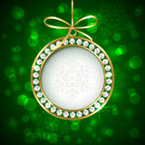 Christmas ball with diamonds on green background Stock Image