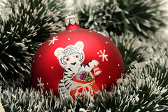 Christmas ball with drawing of tiger Stock Photo